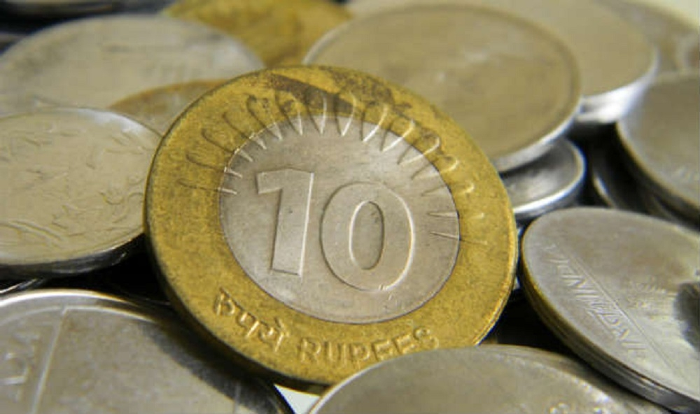 Rupee slips 12 paise to close at 67.54 against US dollar