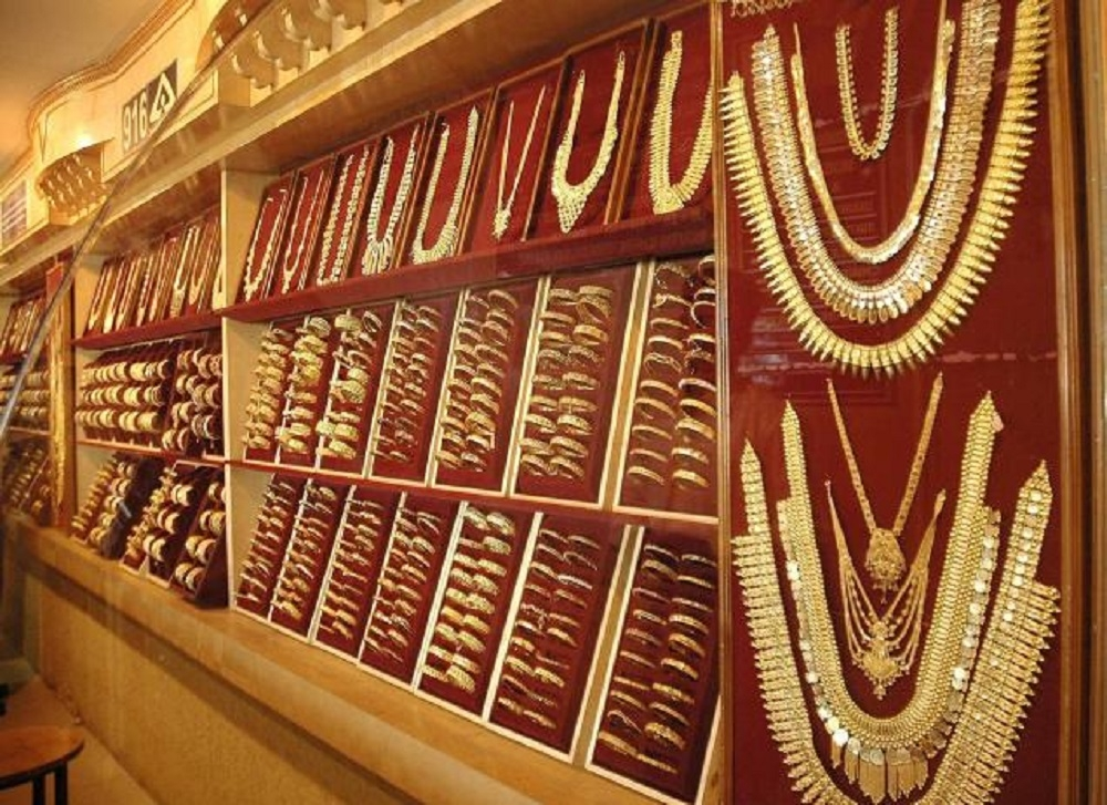 Gold moves up on positive global cues, jewellers' buying