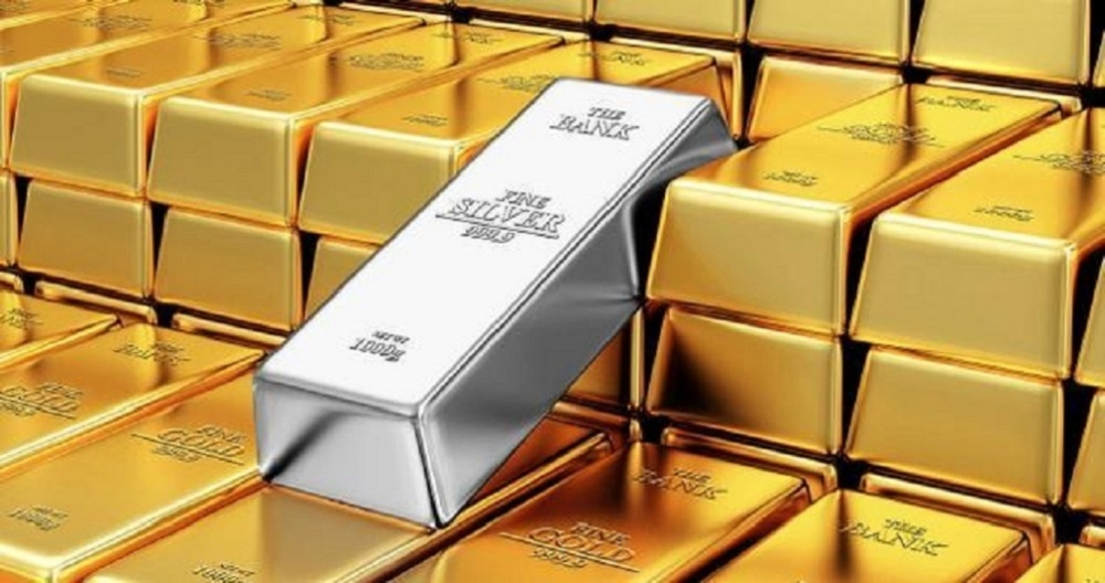 Gold extends losses; silver edges up