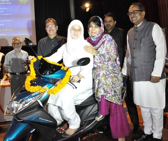 Jammu and Kashmir Chief Minister Mehbooba Mufti with a girl student during launch of Scooty Scheme for Girl Students in Jammu