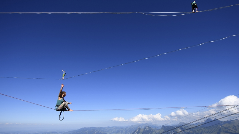 Professional mountaineers walk on lines during the Highline Extreme event on top of the Moleson peak at 2000 meters above sea level in the Swiss Alps near Fribourg in Switzerland