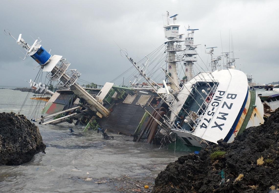 An overturned fishing boat in the aftermath of super typhoon Meranti at Sizihwan in Kaohsiung