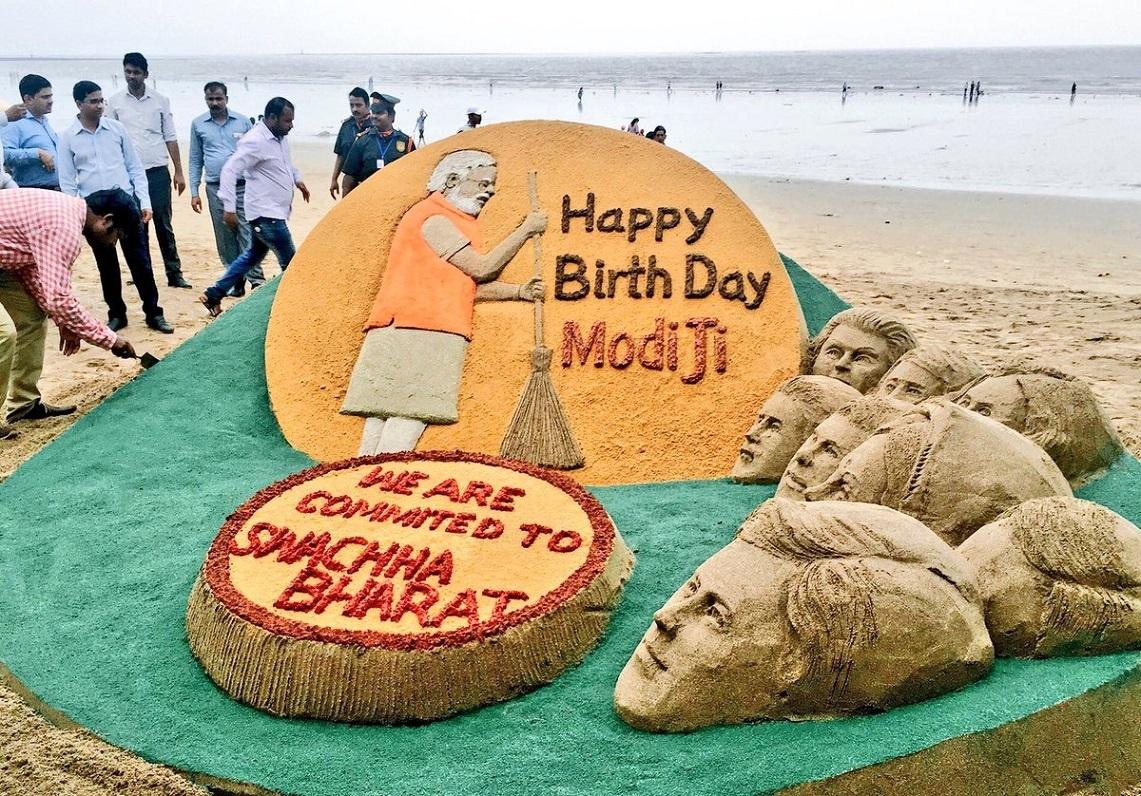Sand artist Sudarsan Pattnaik creates a sand sculpture wishing Prime Minister Narendra Modi on his birthday in Mumbai