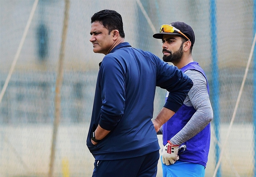 Kumble, left-arm round, to Pujara's help