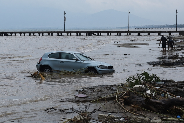 A car is abandoned in the sea in Agia Triada village in northern Greece after heavy overnight rain