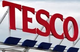 Britain's Tesco buys wholesaler Booker for £3.7 bn