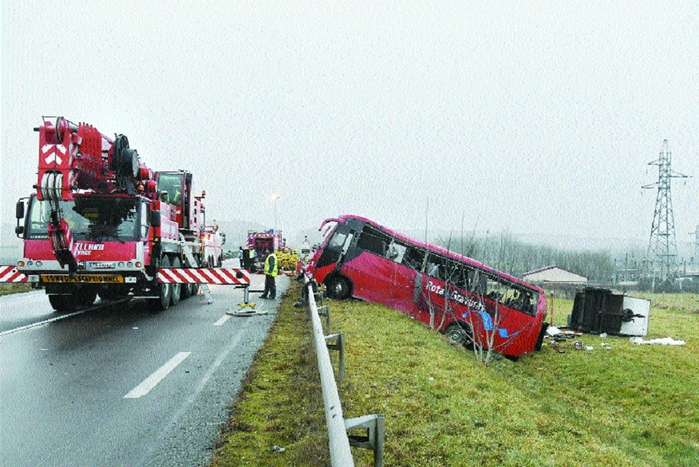 Five killed as bus carrying Portuguese tourists crashes off highway in France