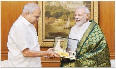Purohit meets Modi