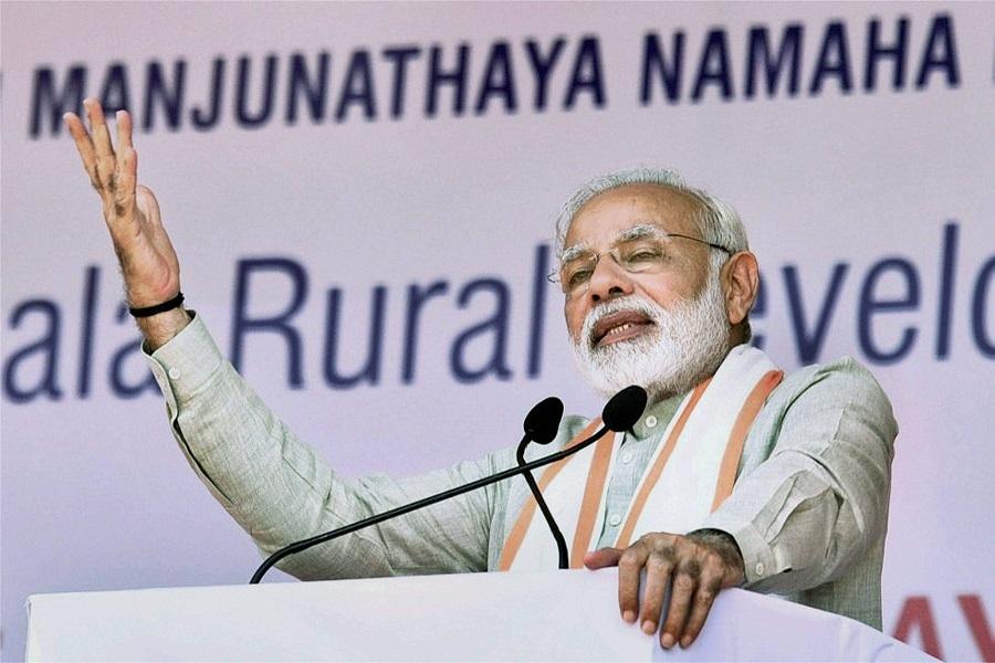 PM slams Congress for speaking Pakistan's language on Kashmir
