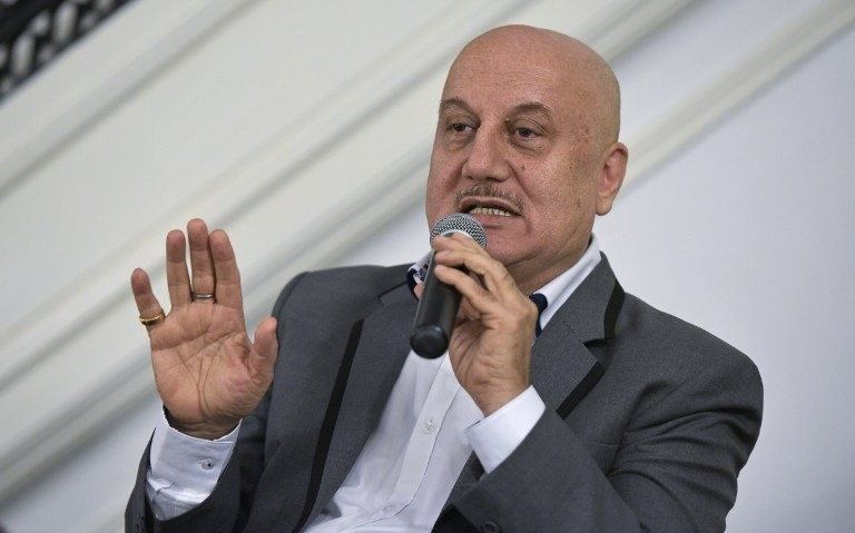 If people can stand in queue at cinema halls, why can't they stand for anthem: Kher