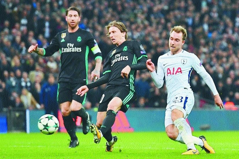 Spurs stun Madrid, join Man City in PQF