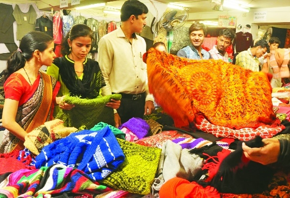 Dip in mercury raises demand for winter wear in city