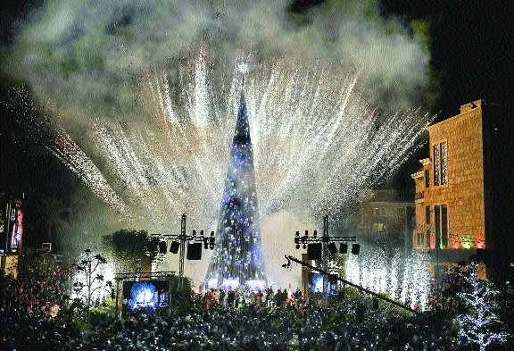fireworks lighting of a Christmas tree in city of Byblos