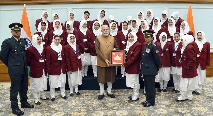 Prime Minister Narendra Modi with the girl students from Srinagar on tour under Sadbhavna Programme of the Indian Army