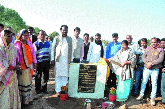 Minister Dhurvey lays stone for cc road