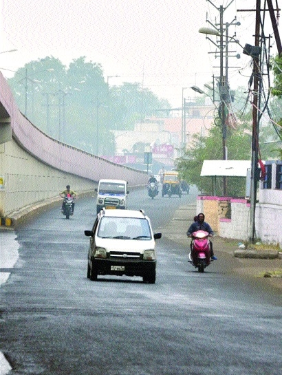 Light showers drench city, haze reduces visibility