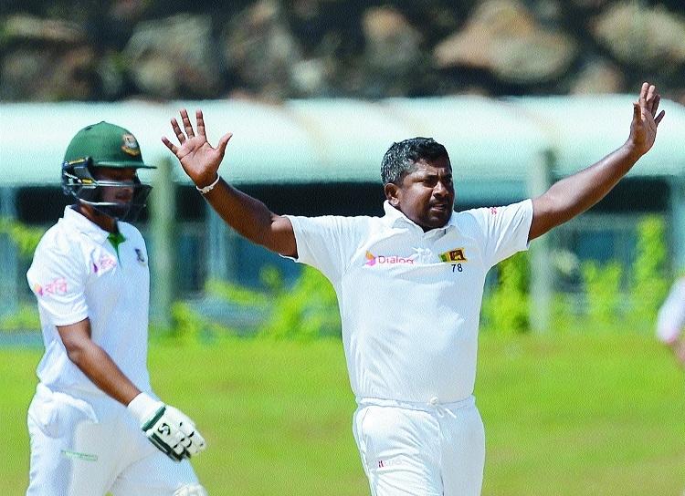 Milestone man Herath spins Lanka to victory