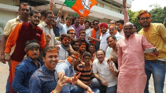 State BJP workers celebrate party's emphatic victories in UP, Uttarakhand