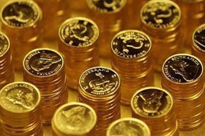 Gold gets demand jolt, slips below Rs 29,000
