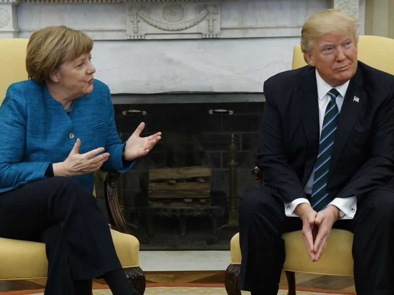 Tensions show as Trump, Merkel hold 'awkward' joint meet for first time