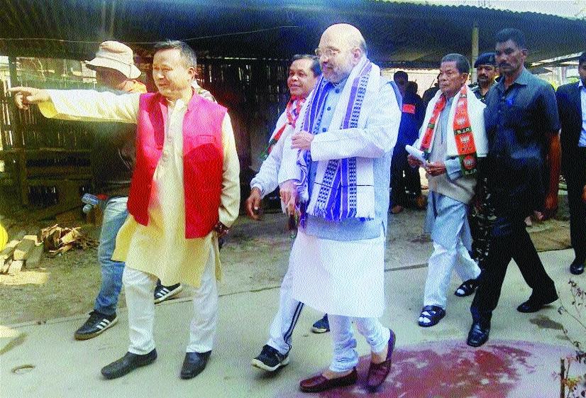 BJP President Amit Shah during a door to door election campaign in Wangkhei