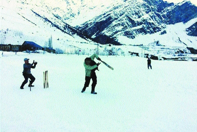 Boys play cricket at a snow covered field in Lahaul Spiti on Wednesday