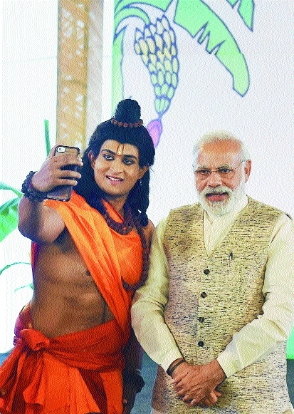 A performer dressed as Lord Ram with  Narendra Modi