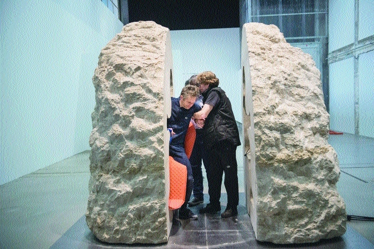 French artist emerges after spending week inside a rock