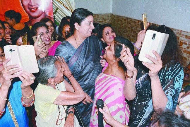 Women taking selfies Smriti Irani  election campaign at Varanasi
