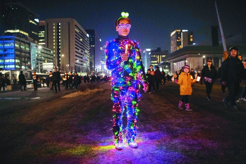 anti Government protester wearing an illuminated costume