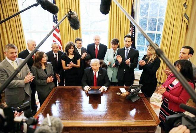 Trump signs new travel ban targeting six Muslim nations