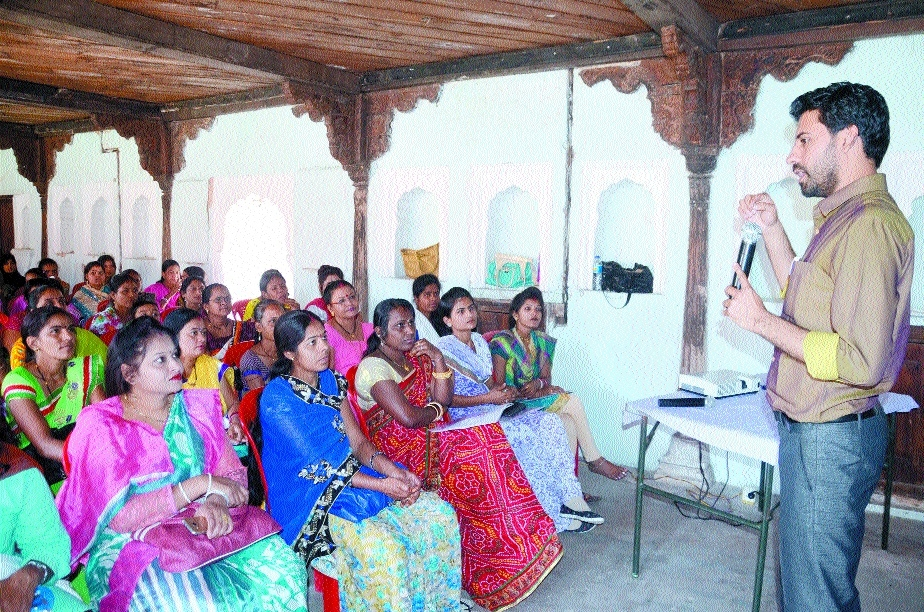 Women crafts workers learn marketing tips from experts in workshop