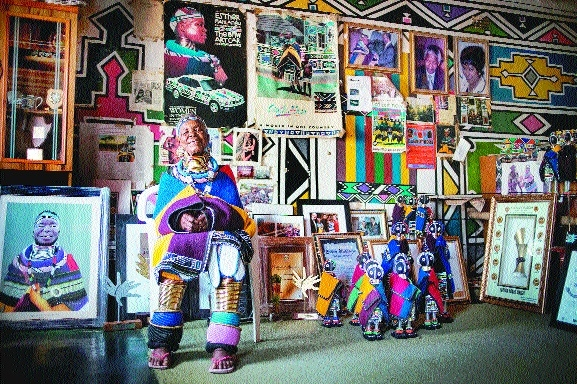South African artist Esther Mahlangu 81 poses at her home