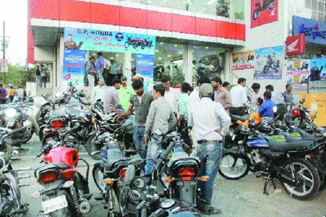 People rush to buy vehicles at  showroom for discount