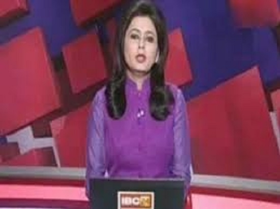 TV anchor puts up brave face, reads out news of her husband's death