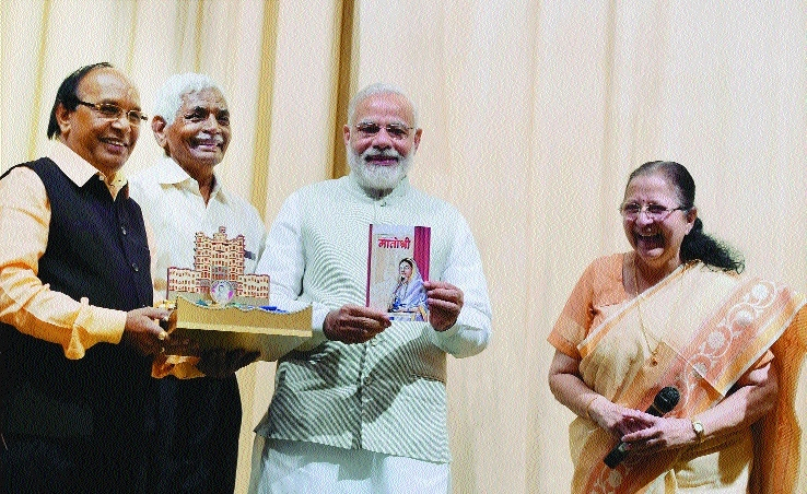Modi releases book penned by Lok Sabha Speaker Mahajan