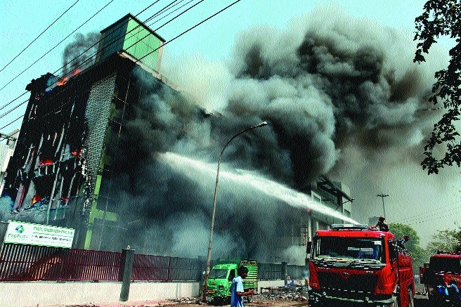 Firefighters douse a fire that broke out in a factory in Noida.jpg