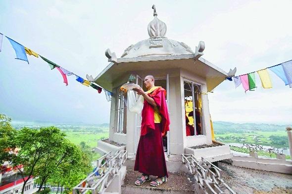 A Buddhist monk offers on Buddha Pournima Amingaon.jpg