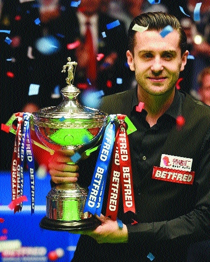 Selby joins elite in retaining world title'