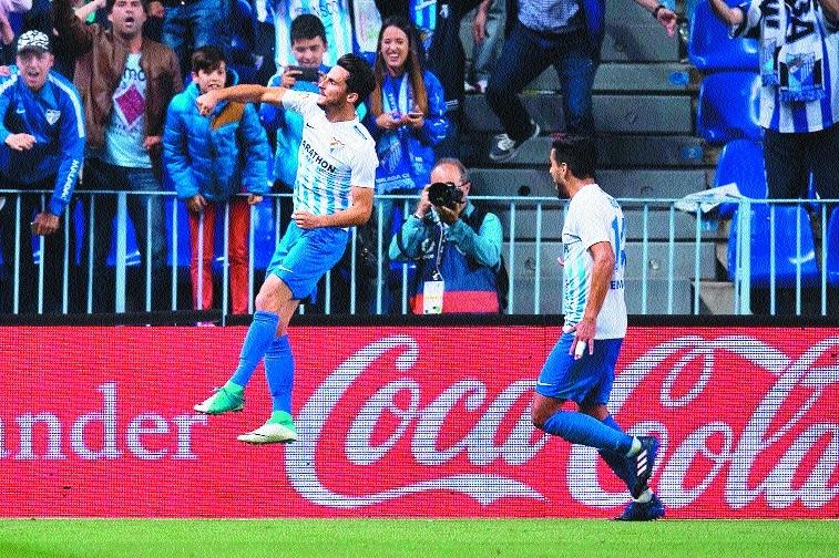 Malaga outplay Sevilla 4-2 in La Liga