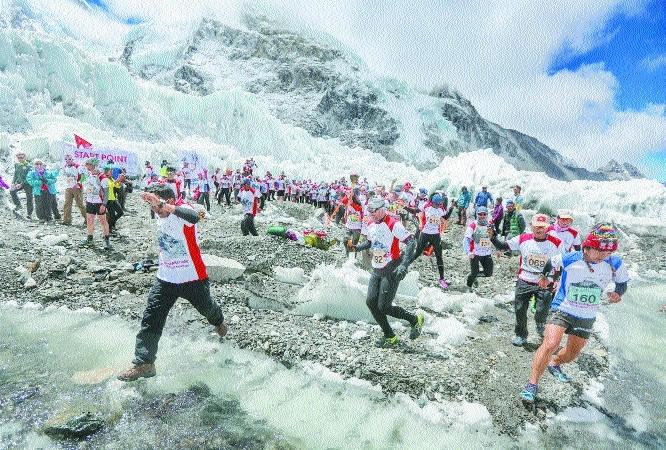 Runners participate in the worlds highest marathon Mount Everest.jpg