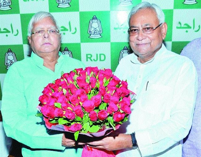Nitish Kumar greets RJD Chief  70th birthday.jpg