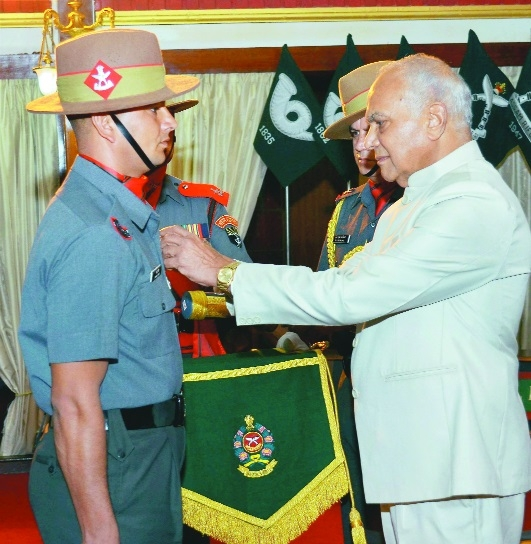 Banwarilal Purohit presenting medals to Assam Rifles personnel.jpg