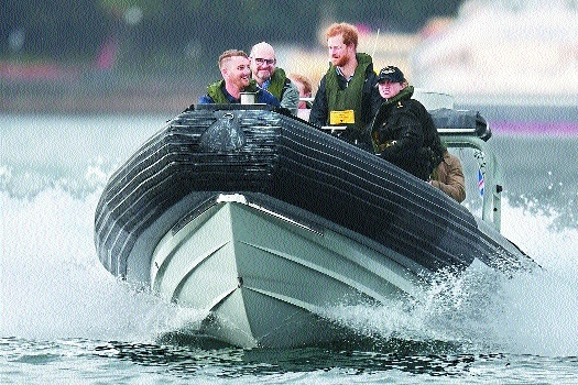 Britains Prince Harry  travels  Sydney Harbour.jpg