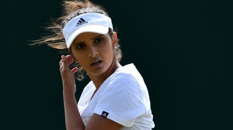 Sania advances in women, mixed events