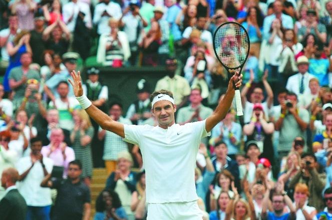 Federer reaches 50th Grand Slam quarter-final