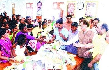 MLA distributes text-books among needy