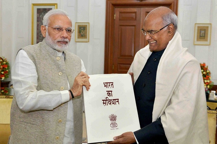 PM presents Kovind copy of Constitution