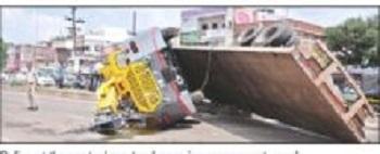 Crane-laden truck overturns, affects traffic