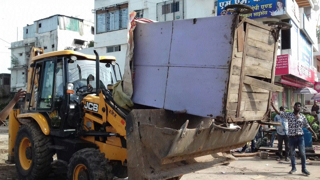 Illegal structures hindering traffic movement removed